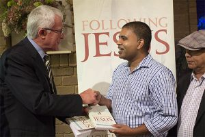 Dr Peter Roennfeldt at his neighbours at the launch of Following Jesus.